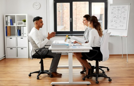 Recruiters having job interview with male employee