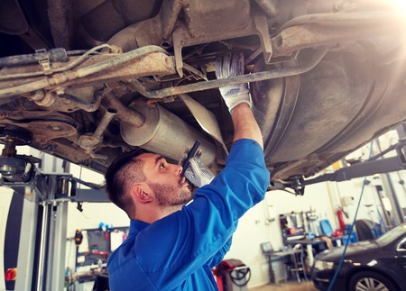 car service, repair, maintenance and people concept - auto mechanic man or smith with flashlight working at workshop 版權商用圖片 - 122209279