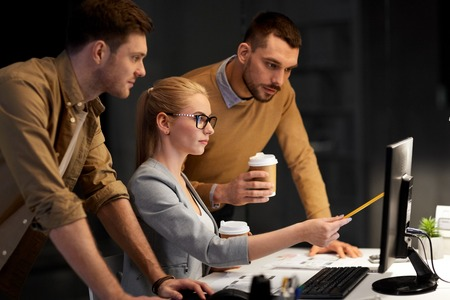 business team with computer working late at office