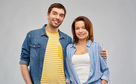 happy couple hugging over grey background Stock fotó