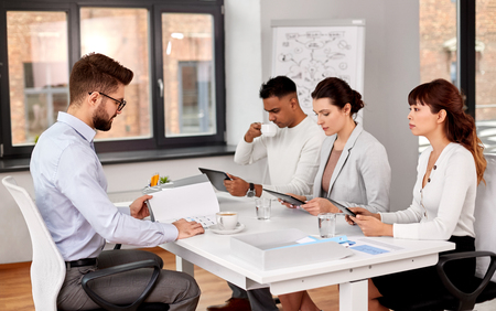 new job, hiring and employment concept - international team of recruiters with tablet pc computers having interview with male employee at office Stock Photo - 122218940