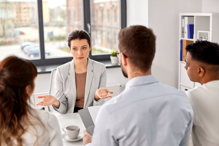 new job, hiring and employment concept - international team of recruiters having interview with female employee at office Stock Photo - 122220852