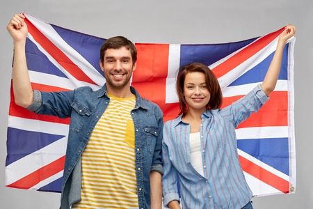 happy couple holding british flag