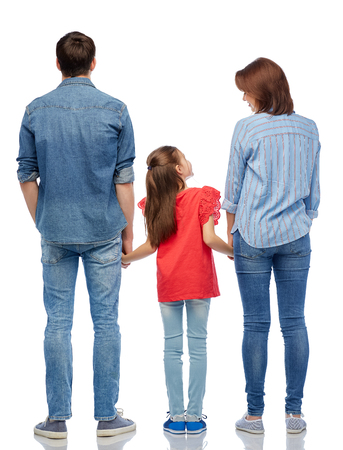 Family and people concept - happy smiling mother, father and little daughter over white background Imagens