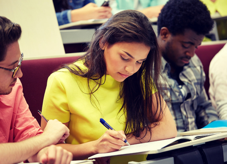 group of international students writing at lecture Stockfoto