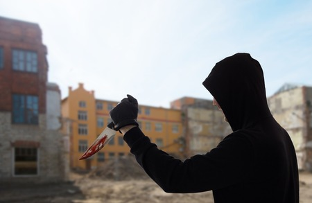 close up of criminal with blood on knife Reklamní fotografie