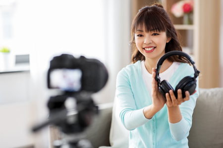 female blogger with headphones making video blog
