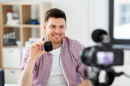 male blogger with smart speaker videoblogging
