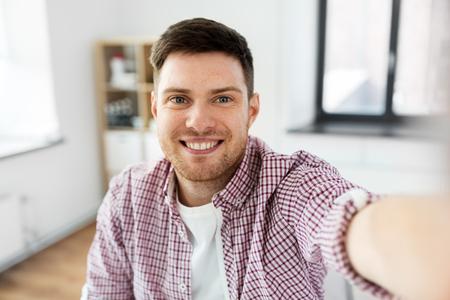 man or video blogger taking selfie Banco de Imagens