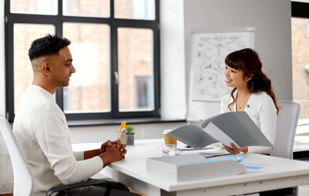 employer having interview with employee at office Reklamní fotografie