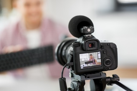 camera recording video blog of keyboard and mouse