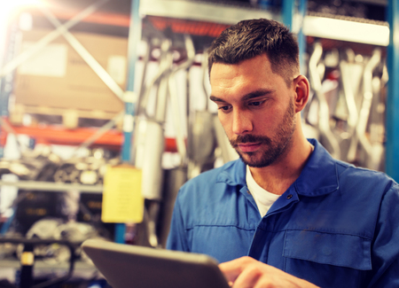 car service, repair, maintenance and people concept - auto mechanic man or smith with tablet pc computer at workshop or warehouse Banco de Imagens - 122616441