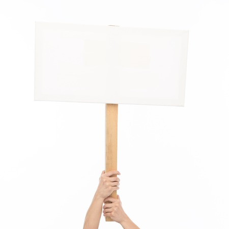 people, advertisement and sale concept - female hands holding blank white board on stick