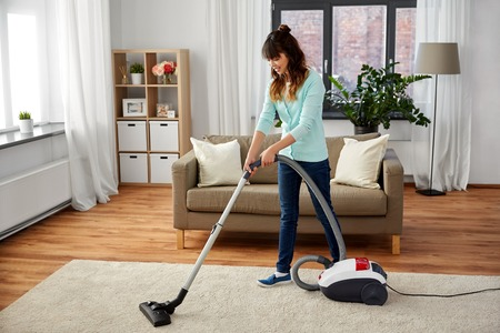household, housework and cleaning concept - asian woman or housewife with vacuum cleaner at home Imagens