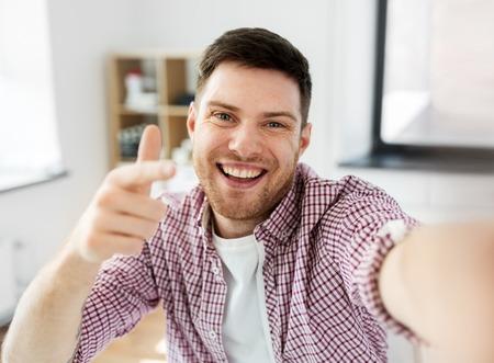 Man on video blogger taking selfie
