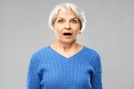 Shocked senior woman with open mouth Stock Photo