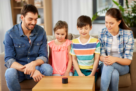 Happy family with smart speaker at home