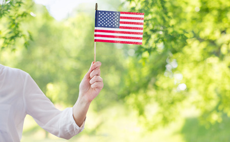 Close up of woman holding american flag in hand Stok Fotoğraf