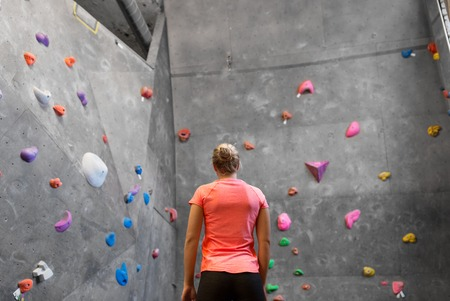 Young woman at indoor climbing wall in gym Reklamní fotografie