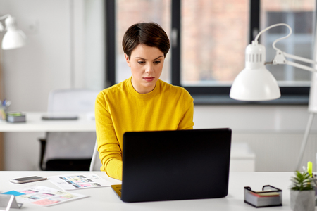 UI designer with laptop working at office