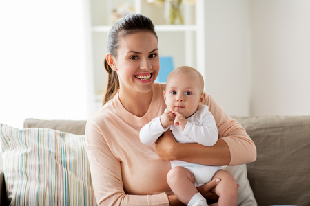 Happy mother with little baby boy at home Imagens