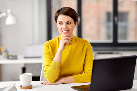 Businesswoman with laptop computer at office Imagens