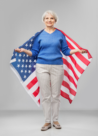Senior woman with flag of united states of america