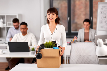 Female employee with personal stuff at office