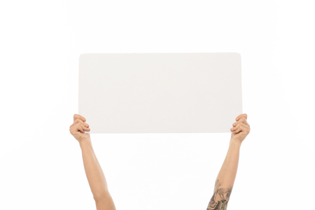 advertisement concept - hands holding blank white board