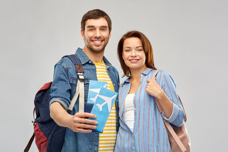 happy couple with air tickets, bags and passport Stockfoto - 123075110