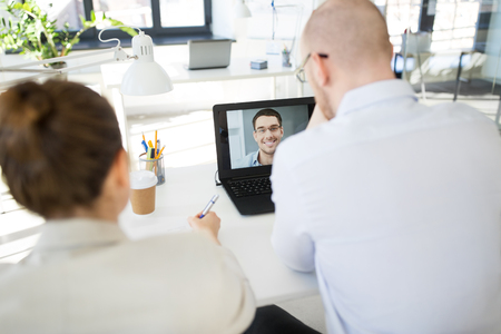 business team having video conference at office Stock Photo - 123075117