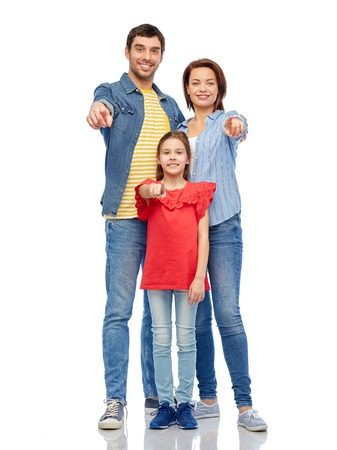 happy family pointing to you over white background Stock Photo
