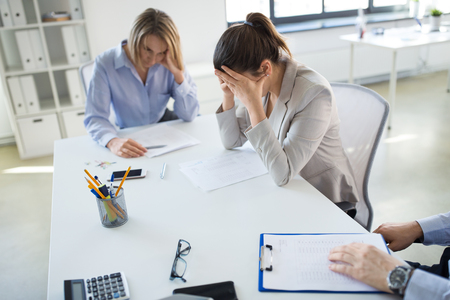 business, failure and people concept - stressed colleagues team with papers at office meeting Banque d'images - 123227176