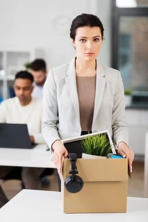 female office worker with box of personal stuff