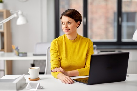 businesswoman with laptop computer at office Stock Photo