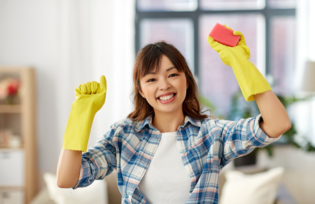 happy asian woman with sponge cleaning at home