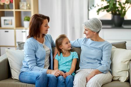 smiling mother, daughter and grandmother 版權商用圖片