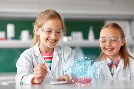 kids making chemical experiment at school lab Stock Photo