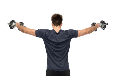 young man with dumbbells exercising