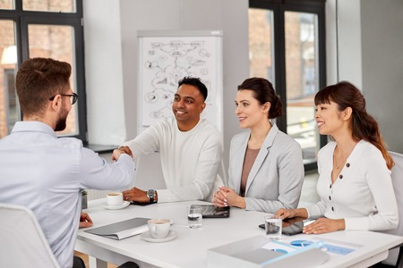 Recruiters having interview with employee