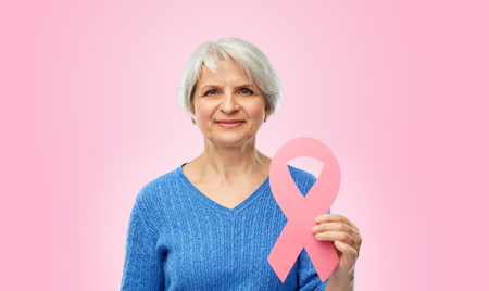 old woman with pink breast cancer awareness ribbon