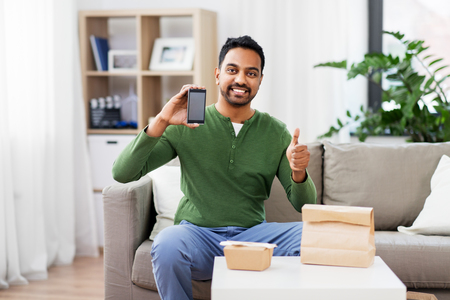 indian man using smartphone for food delivery 스톡 콘텐츠