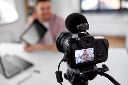 camera recording video blogger with tablet pc