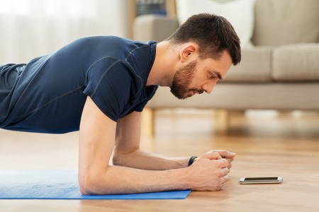 man doing plank exercise at home Archivio Fotografico