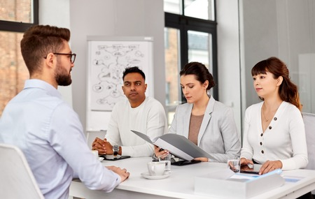 recruiters having job interview with male employee Stock Photo - 124407446
