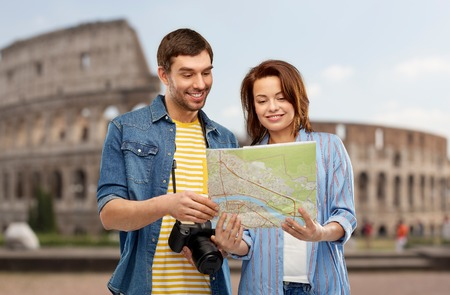happy couple of tourists with map and camera