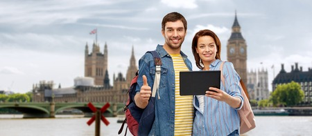 couple of tourists with tablet computer in london