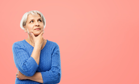 portrait of senior woman in blue sweater thinking Imagens - 124766688