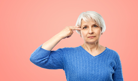 senior woman making finger gun gesture