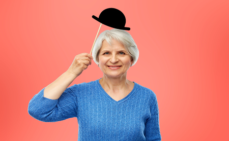 funny senior woman with vintage party hat Stok Fotoğraf